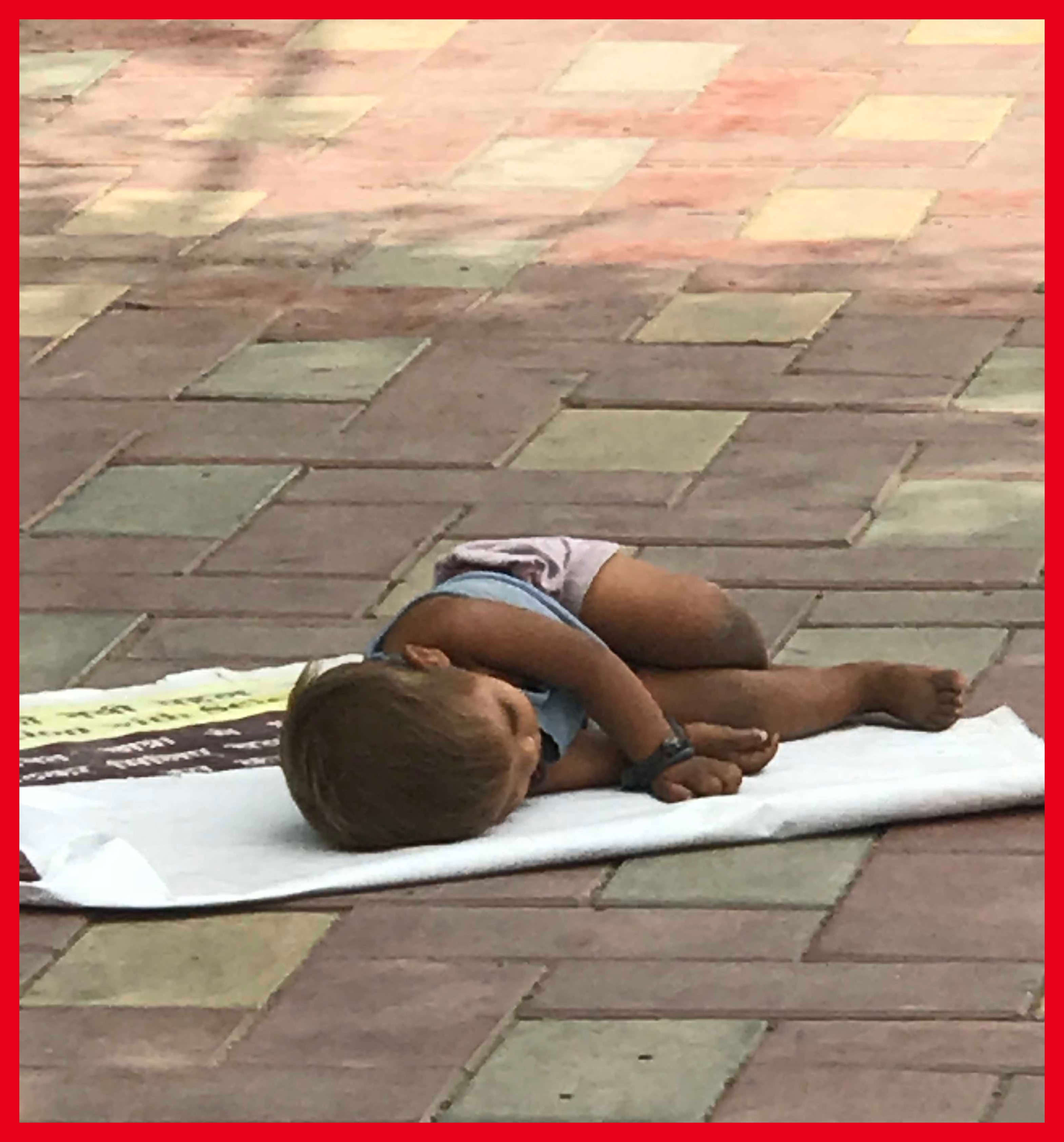 A lonely child sleeping on the pavement/TNL Archives
