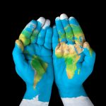 Planet earth painted on two hands. Image source - Twitter