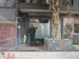 An ED official standing outside the Newsclick office in New Delhi