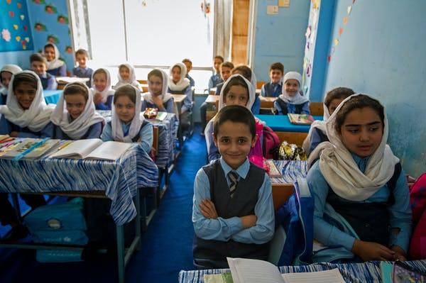 A coed private school classroom in Kabul, September 2019. Girls' education is still restricted in Taliban-controlled areas. Scott Peterson/Getty Images