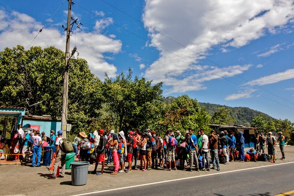 Venezuelan migrants receive food and medicine from the Red Cross near the Colombia-Venezuela border, February 2021. Schneyder Mendoza/AFP via Getty Images