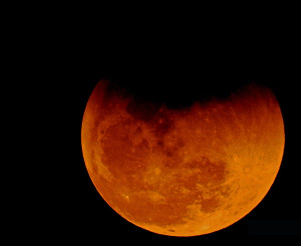 The Earth's atmosphere gives the Moon a blood-red glow during total lunar eclipses. Irvin Calicut/WikimediaCommons, CC BY-SA