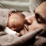 A father and child enjoy a moment of unconditional trust through the practice of freedom.